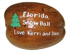 Personalized hand painted coconuts for holiday gifts Palm Frond Art, Palm Fronds, Christmas Palm Tree, Christmas Ideas, Coconut Ideas, Coconut Shell Crafts, Florida Decorating, Coconut Fish, Palm Tree Decorations