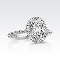 If nothing else, I hope he learns that all I want is an oval diamond... This exact ring would be perfect.