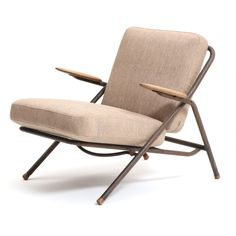 "Hans J. Wegner: ""GE 250"". Rare foldable easy chair with metal frame, oak armrests and shoes. Manufactured by Getama, Gedsted."