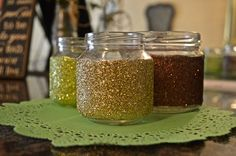 upcycle jars to glittery votives : clean and dry jars. sponge paint diluted school glue and shake lots of glitter on them.  let dry. put candle inside and give your event a little sparkle.