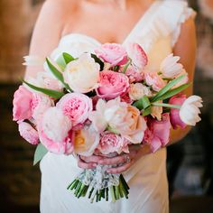Brides.com: . A pink bouquet comprised of garden roses, tulips, and ranunculus created by Bows + Arrows.