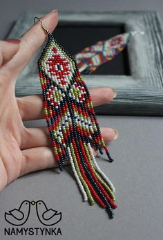 These beaded fringe earrings are made of high-quality Czech beads and strong synthetic thread. They are elegant, fashionable, and highly versatile, suitable for everyday wear. Features: Sterling silver components Color: brown, red, green. white Length (approximate): 15,5 cm (6.1 in) This