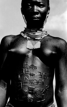 nubian tribes of africa | Nuba woman with tribal body marks. Circa 1896