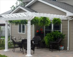 "8 X 12 Vinyl 2 Beam Pergola Shown With Wall Mounted Kit, No Deck, 8"" Round Tapered Vinyl Columns, and 12"" Top Runner Spacing"