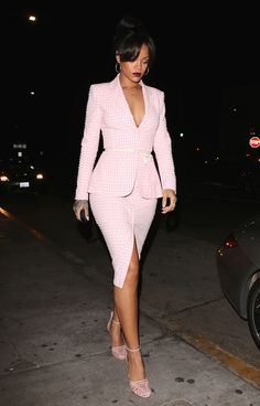Rihanna embraced Spring 2015's gingham trend at one of her favorite restaurants, Giorgio Baldi, in a pink skirt suit from Altuzarra's Spring 2015 collectio