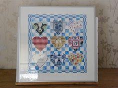theedoek in aquarel met kleine aquarellen en stof. afm 50x50 incl. aluminium lijst. te koop voor 125 euro