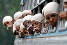 Children dressed as Mahatma Gandhi arrive on a bus to take part in a peace march in Kolkata January 29, 2012.