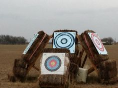 Views of mounted archery targets: looks like 4 bales on a wood stand.  Could make with wheels for easy moving... A Company Mounted Archery
