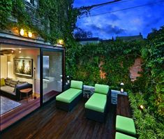 This ipe-clad patio is planted with English ivy that crawls up the walls and winds itself along telephone wires.