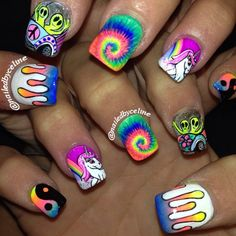trippy nails complete with ying and yang, unicorns, tie dye, aliens and rainbow fading drips- thanks for coming @angelinagalvis_  #nailedbyceline #nailart