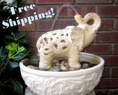 Elephant's Shower Water Fountain- Indoor and Outdoor Water Fountain- Garden Decor - Free Shipping. $82,00, via Etsy.