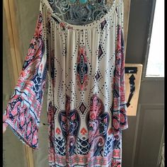 Bare shoulders print dress size Xl Size Xl print shorter style dress to tunic bare shoulders bell sleeves fits true with poly/spandex Boutique brand  Dresses Long Sleeve