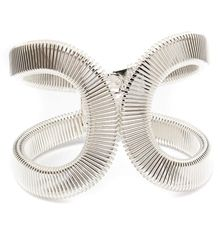 Let your accessories do the talking with this unique statement bracelet. In a bold geometric design, these metal wire bracelet will look great with trend setting attire! $14.99