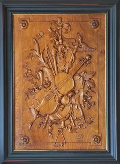 Bespoke wood carving | high end architectural wood carvin | Patrick Damiaens | Musical trphy carved in walnut | http://www.patrickdamiaens.be