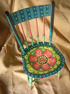 Earlier in the winter I painted a variety of wooden chairs, one with an upholstered seat. They were all pretty much vintage, and the uphols...