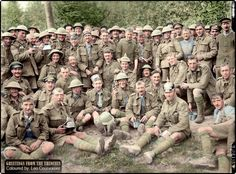 Group of Royal Fusiliers near Aveluy Wood after the capture of Thiepval on 26 September 1916. Aveluy, Somme, France. Men wear captured German headwear (including one numbered '180') and carry captured weapons.