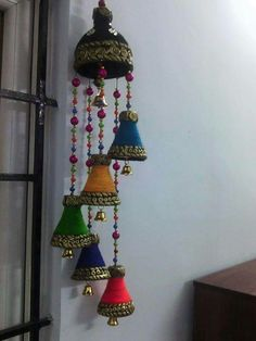 Wind chimes here is the procedure for wind home 5 bottles of small coca-cola bottles & 1 big bottle & put holes on the top portion of the ca Plastic Bottle Tops, Plastic Bottle Crafts, Diy Bottle, Diwali Diy, Diwali Craft, Diy Home Crafts, Easy Crafts, Hobbies And Crafts, Arts And Crafts