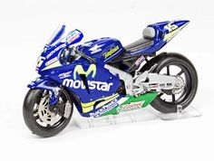 This Honda RC211V (Sete Gibernau - 2005) Diecast Model Motorcycle is Blue and features working wheels. It is made by Ex Mag and is 1:24 scale (approx. 8cm / 3.1in long).  ...