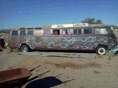 A completely custom, and well made stretched VW Bus. It looks like 3 buses were used in this project. Is that a dually axle I see back there?