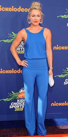 Last Night's Look: Love It or Leave It? Vote Now!   LINDSEY VONN   in a (backless!) sky-blue jumpsuit with a white Nancy Gonzalez clutch and Dannijo earrings, which she offset with a bold lip, at the Nickelodeon Kids' Choice Sports Awards in Westwood, California.