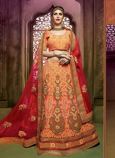 This delightful diva accoutre features unique styling and unusual material. Be the sunshine of everyone's eyes dressed in this beautiful peach art silk a line lehenga choli.