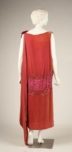 Evening dress House of Worth  (French, 1858–1956)   Date: ca. 1926 Culture: French Medium: silk, glass, metal. Back