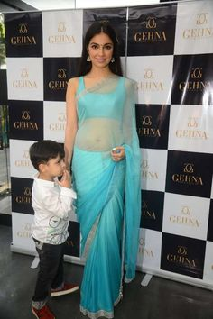 Actor and director Divya Khosla Kumar looked sexy in an icy blue Shaina NC chiffon sari. She is seen in the picture with her son Ruhaan Kumar.