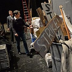 Mimi Intagliata, director of production for Disney Theatrical, gives a tour of props backstage as production crews work on the 'Newsies' set at Proctors Theatre on October 9.