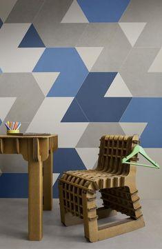 Disegnata da HOK Product Design la collezione Nest della serie Slimtech si compone di moduli dalla forma irregolare che si combinano formando degli esagoni, creano intrecci colorati dal forte impatto decorativo.