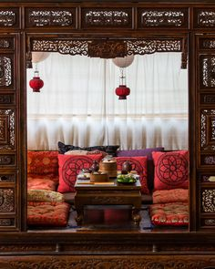 Tea, dumplings and greens on a Chinese daybed at Red Door. James Morgan