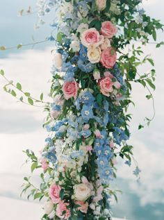 Love this pretty pink and blue flower arch!