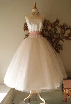 This 50's style polka dot tulle wedding dress was quite the heart-breaker--in more ways than one!