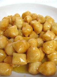 'Struffoli, little sweet treat'..these are a holiday treat in Italy..they are not only for the mafia or Sopranos..he, he!