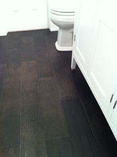 "Faux wood tile--Rods are starting this today! Home Depot porcelain tile in ""Saddle."""