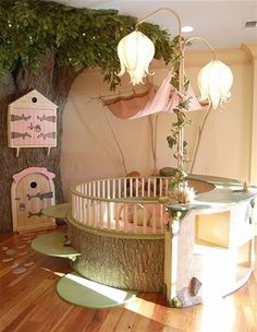 Yes, that would be a tree in this baby's nursery. Talk about whimsical! A circular crib with a hanging canopy makes for a beautiful night's sleep.