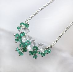 Belle des Prés ~ A sweet, delicate necklace featuring gem grade Herkimer Diamonds and natural color Colombian Emeralds.