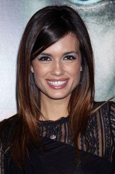 Torrey DeVitto's glossy, brunette hairstyle