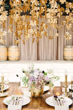 A metallic gold leaf hanging installation is the perfect addition to a tablescape for a fall wedding.