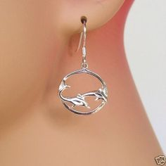 Dolphins in Circle Earrings. Sterling Silver.