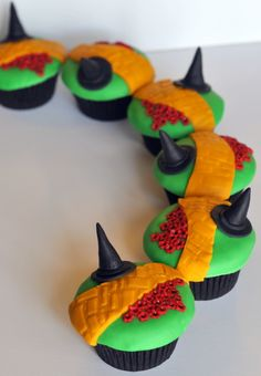 sub for: green frosting with yellow fondant brick road and red icing flowers with witch hat on pick