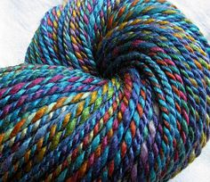 "SheepingBeauty on Etsy. ""Mogodor"" multicolor yarn hand-spun from wool & silk fiber dyed by Fleece Artist."