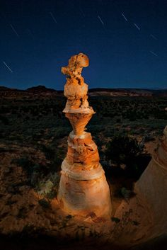 In the Coyote Buttes, a natural column of rock called a hoodoo and nicknamed the Totem Pole towers against star tracks, revealing the passing of time along its banded length like the rings of a tree.      www.richardbarnes.net