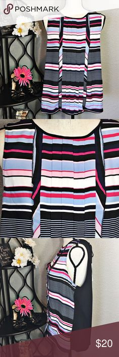 """Elle Striped Sleeveless Pleated Scoop Neck Blouse Pretty pink, blue, black and white striped sleeveless blouse. The pleats go all the way down the front of the top. The front is lined. It has a keyhole opening in the back with a tie. Bust: 41""""; Length in the back from the shoulder: 25 1/2"""".   Smoke free home. 🌺Thank you for shopping my closet 😊🌺 Elle Tops Blouses"""