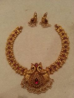 Antique gold necklace and earrings with peacock design