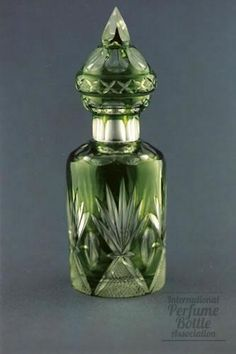 "Green Cut to Clear Glass.  Brule Perfume  Material(s):glass and metal  Designer/Maker:Likely Baccarat or Cristal Saint-Louis  Markings:none   Date or Era:c. 1920s  Dimensions:7 1/2"", 19.1 cm H  Additional Information:  Case glass with green cut to clear, cut matching top. Ref: Perfume Bottle Quarterly, Winter 1999."
