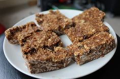 HOMEMADE GRANOLA BARS    -1.5 cups of oats    -1/2 cup of coconut    -1 ripe banana    1/2 cup of chocolate chips (or as many as you want)    1/2 raisins (which I didn't have, so I went without)    1/2 cup maple syrup or agave nectar    1/2cup peanut butter (I used almond butter)    2Tb of flax seed (optional)    1.5 tsp cinnamon    1tsp vanilla