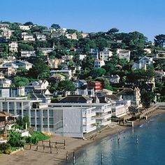 Sausalito, California    Perched on the steep, wooded hillsides that give way to Marin County's Richardson Bay, this town of more than 7,000 lucky souls just north of the Golden Gate Bridge is surrounded by the lush Golden Gate National Recreation Area. (Locals rave about nearby Muir Beach's clean white sands and crystal-clear water.) Sausalito is home to about 400 houseboats, as well, and has one of the only open marinas on San Francisco Bay's coast.