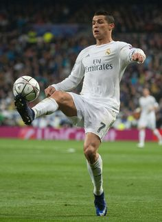 Real Madrid's Portuguese forward Cristiano Ronaldo controls the ball during the Champions League quarter-final second leg football match Real Madrid vs Wolfsburg at the Santiago Bernabeu stadium in Madrid on April 12, 2016.