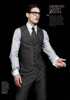 matching grey vest and pant, grey tie, pinstripe shirt with french cuffs, black frames