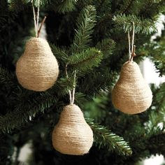 Harvest christmas charm to give your Christmas tree a rustic touch. These cute Twine Pear Christmas Ornaments are handmade of natural twine carefully wrapped around a perfect pear shape and topped with a real twig stem.  #RusticChristmas #HolidayDecor #ChristmasDecor #ChristmasDecoration #ChristmasOrnament #TreeOrnament #HandmadeChristmasOrnament